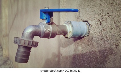 Old Tap Water on a wall