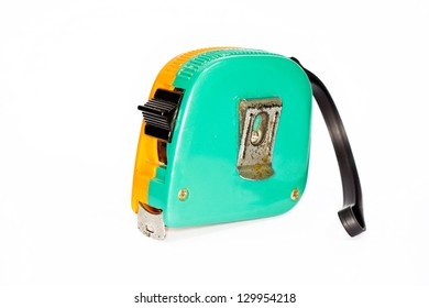 The old tape measure on white background