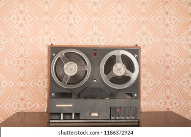 Old tape recorder on wooden table