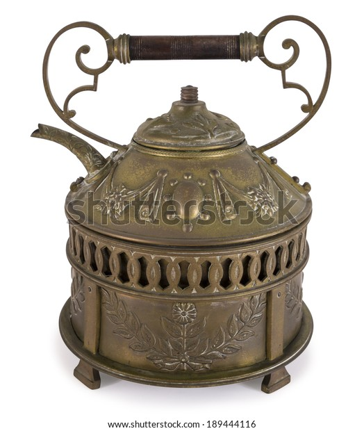 Old teapot made of bronze on white background isolated including path