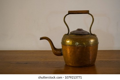 Old teapot on the table