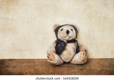 old teddy bear dressed as a pilot
