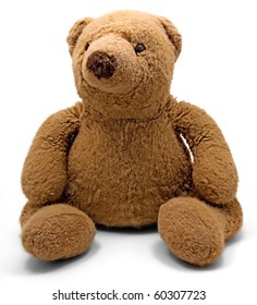 An old teddy bear on a white background