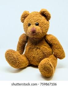 Old teddy bear, red teddy bear on white background