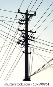 Old Telegraph pole and wires in silhouette