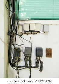 old telephone box system control on wall
