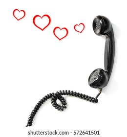Old telephone handset and red heart on white background., Valentine day.