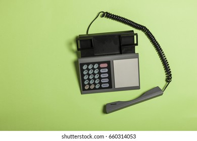 A old telephone on the green background.
