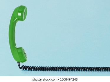 Old telephone receiver with cord