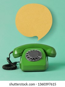 Old telephone with speech bubble