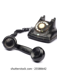 Old telephone in white background