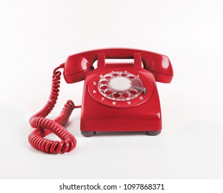 old telephones on white background