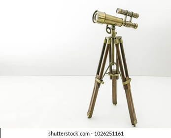 Old telescope on White Background   Antique telescope on white background. Concept of time.