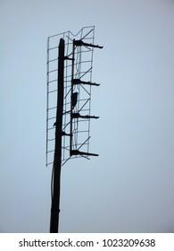 old television antenna, sky in background