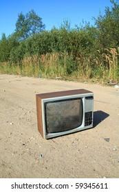 old television set on rural road