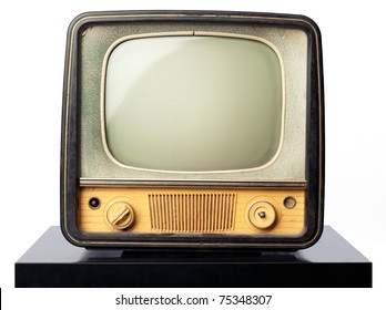 An old television standing on a black table on white background. Put your image or design on the screen