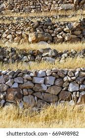 Old terraced fields with barley on Kimolos island in Greece.