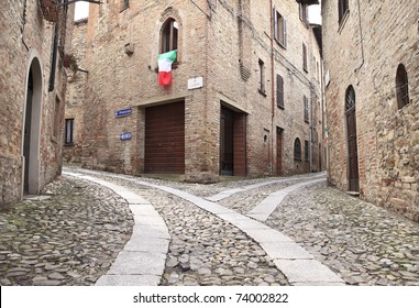 Old terraced houses on cobbled alleyway, Castell'Arquato, Italy