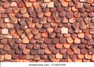 Old terracotta tiles on roof texture background