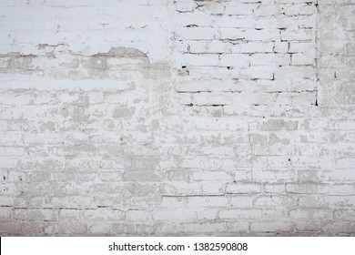 Old textured brick wall with natural defects. Scratches, cracks, crevices, chips, dust, roughness, grungy. Can be used as background for design or poster.