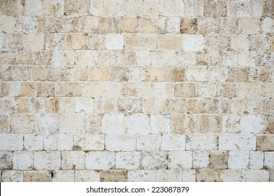 Old textured stone wall background in textured white Istrian marble on the Stradun in Dubrovnik Croatia
