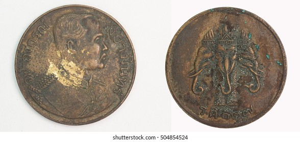 Old Thai coin on white background