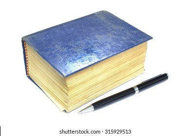 Old thick book blue cover and pen on white background.