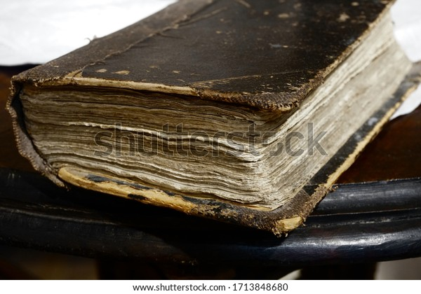 An old and thick book on the table. Old bible.Religion concept.