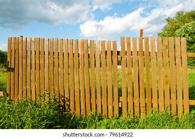 old thrown fence in wood