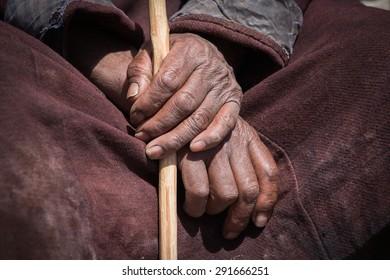Old Tibetan man hand in Lamayuru Gompa, , Ladakh, India. Close up
