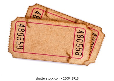 Old ticket : Pair of torn blank movie or raffle tickets isolated on white.  Space for copy.