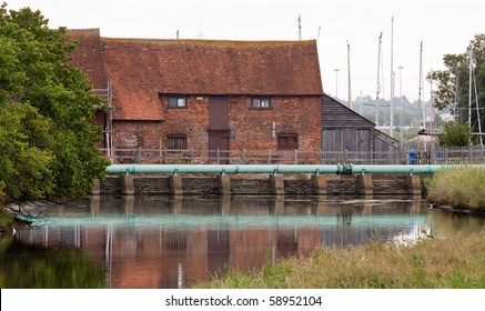 The old tide mill at Eling at the edge of the New Forest The mill traps the water in a pond at high tide and uses the energy as it drains back during low tide.