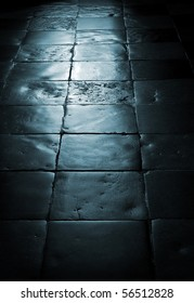old tile floor with blue light shining on it