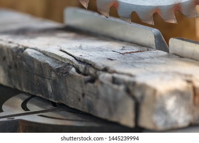 Old timber strip with teeth circular saw in workshop