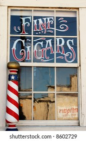 Old time barber shop window with writing on it