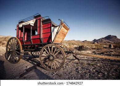 Old time horse drawn wagon in the desert town of Calico . An 1890's silver boom town in the mojave desert.
