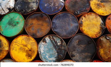 Old tin barrels from the oil. Background, abstract pattern. Colorful cans on the street. Old vintage cask. Rusted oil tins. Cans with chemicals.