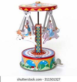 old tin spinning toy