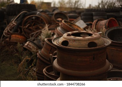 Old tire and rim at the junkyard