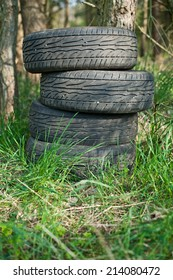 Old tires left in the woods. Illegal waste dump.