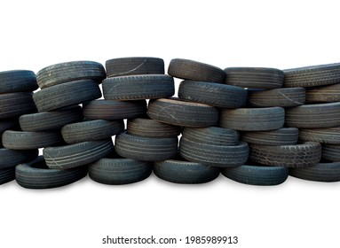 old tires stacked in layers Overlap in long rows, reusable for bunkers. shockproof, in the racetrack, reduce injuries, accidents on a white background, isolated