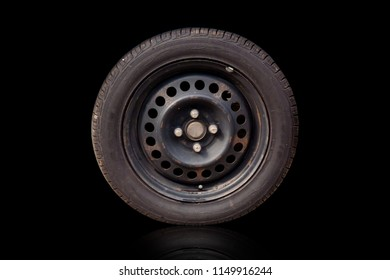 Old tires wheels separated from the black background