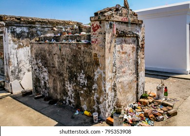 Old tomb at St. Louis Cemetery No. 1 in New Orleans shows evidence of Voodoo worship, April 2012