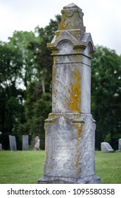 old tombstone  in a historic graveyard - portrait