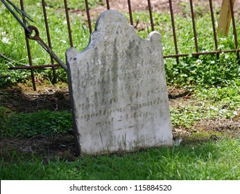 An old tombstone outside of a church in NJ