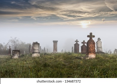 Old tombstones in abandoned old cemetery