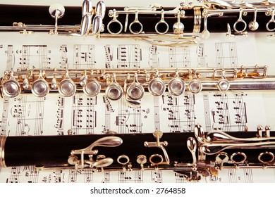 Old tone clarinet and flute over sheet music