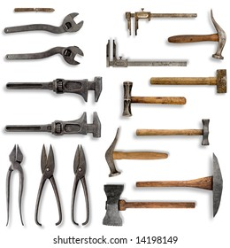 Old tools in front of a white background