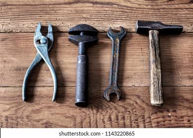 old tools on wooden background