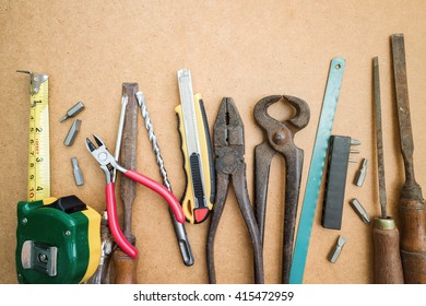 The old tools on a wooden background